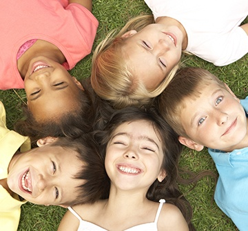 Group of kids smiling together outdoors