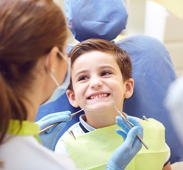 A young boy in the dentist chair having his teeth checked